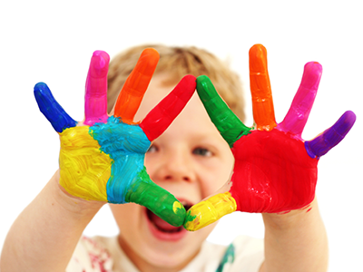 Kid with colored paint on hands