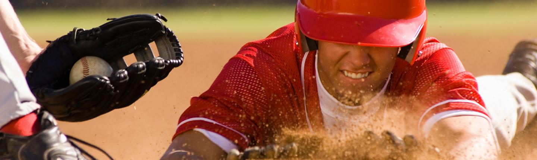 Baseball player sliding into base.