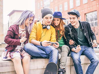 Group of teens looking at a phone