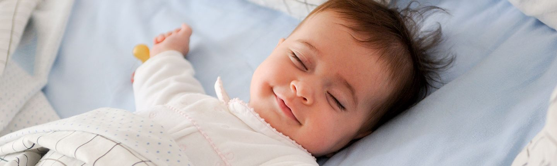 Sleeping smiling baby.