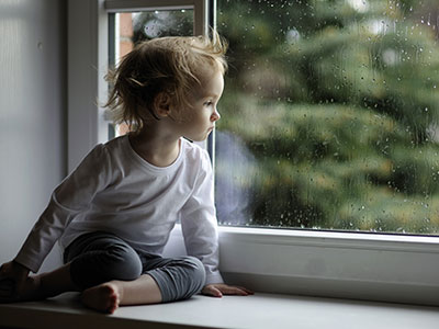 sad child in window