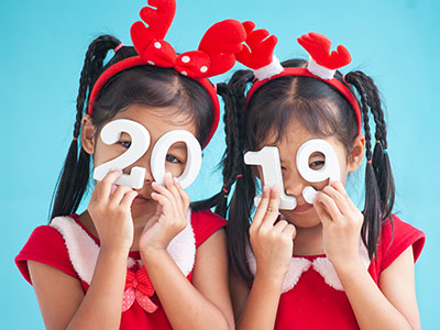 Two little girls holding 2019 sign-feature