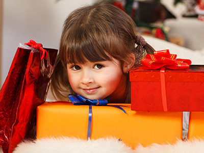 little girl with lots of presents