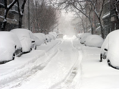 a road full of snow covered cars