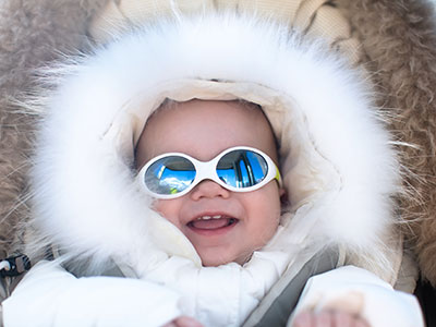 baby-with-winter-coat-and-sunglasses