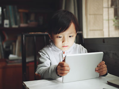 little boy looking at tablet
