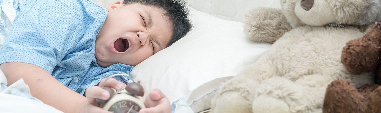 Boy waking up yawning