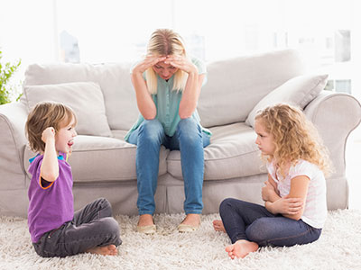 two girls arguing in front of mom