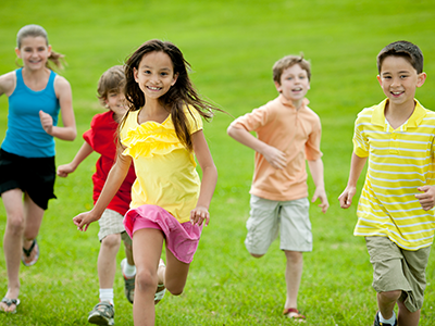 Kids running in a field