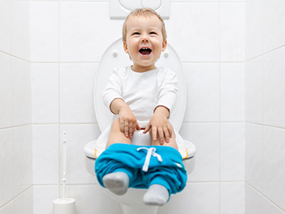 Little boy on toilet