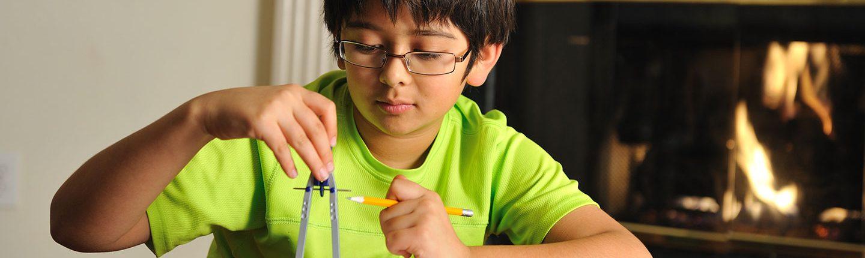 little boy doing math homework-feature