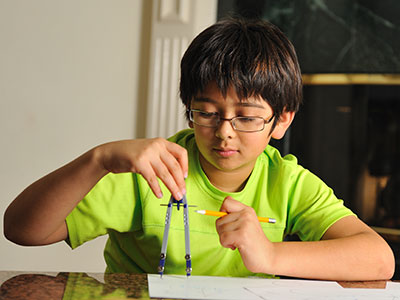 little boy doing math homework-feature