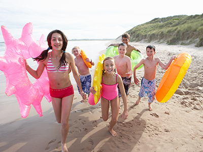 Teenagers running on beach