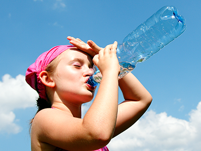 girl drinking water to stay cool on a hot day