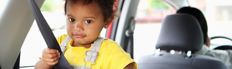 little girl sitting in car