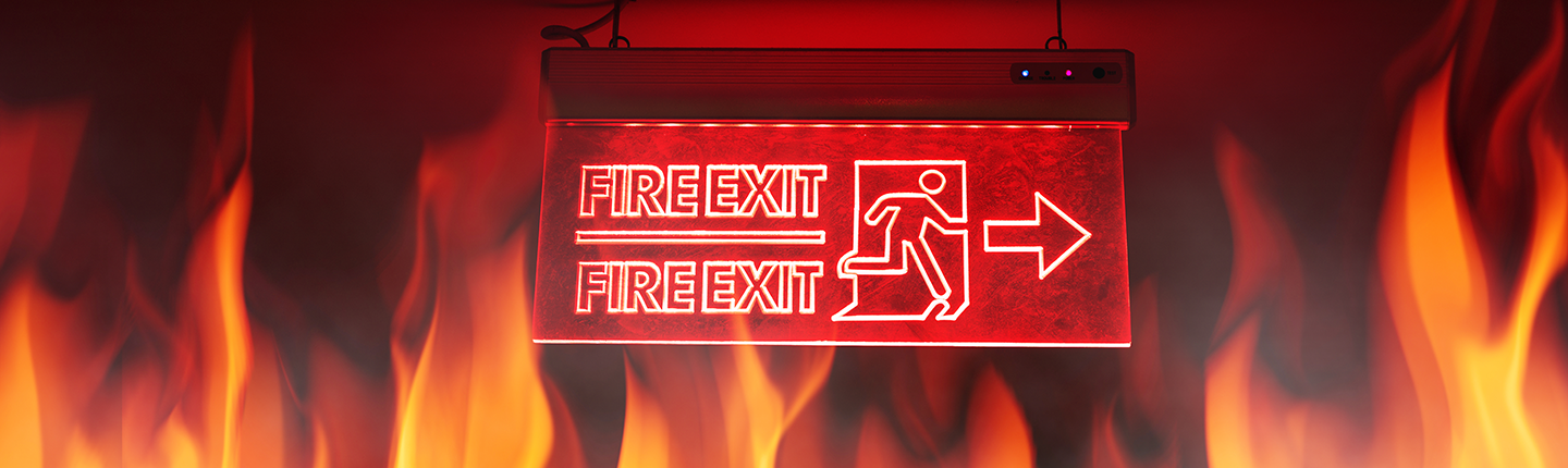 Fire exit sign with flames