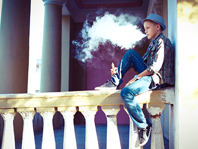 boy in hat vaping