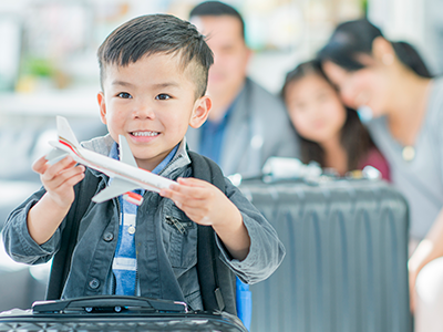 little boy holding toy airplane