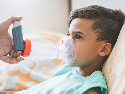 boy using nebulizer