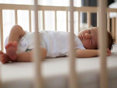 baby sleeping in a crib
