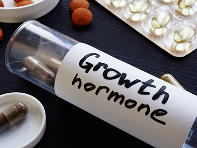Bottle with pills and label Growth hormone