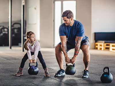 little girl doing crossfit