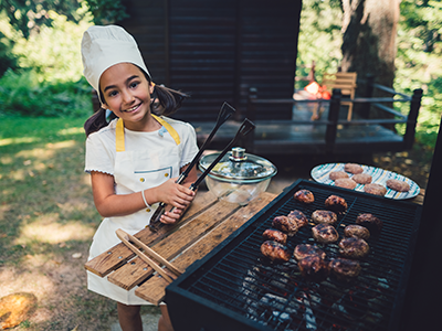 girl preparing barbecue in the garden