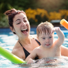 boy with Down syndrome having fun in the swimming pool