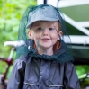 little boy with mosquito netting hat
