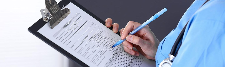doctor filling out medical form
