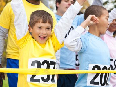 kids crossing a race finish line
