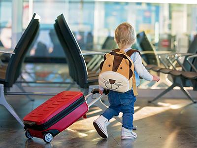 child pulling suitcase