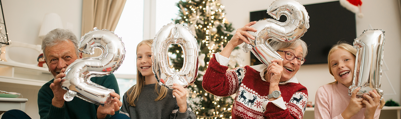 family celebrating new years 2021