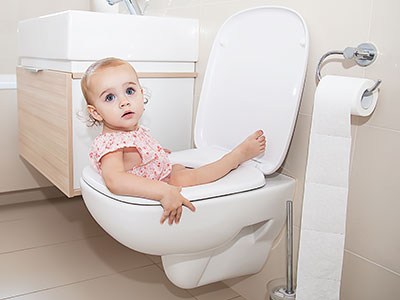 little girl in toilet
