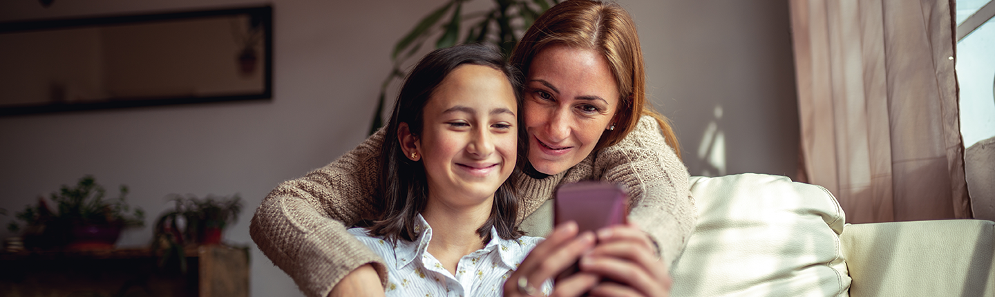 Mother and daughter using a smartphone