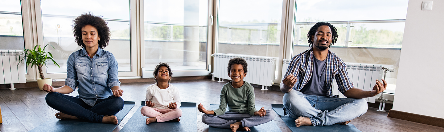 African American family meditating