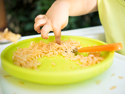 infant eating rice