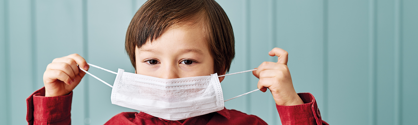 child wearing surgical mask