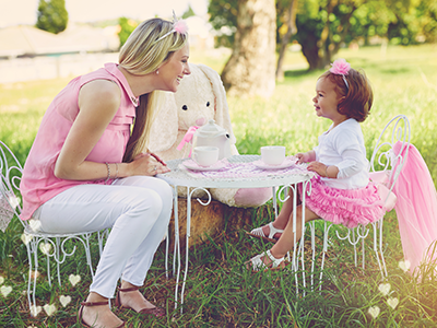 mom and daughter having a tea party