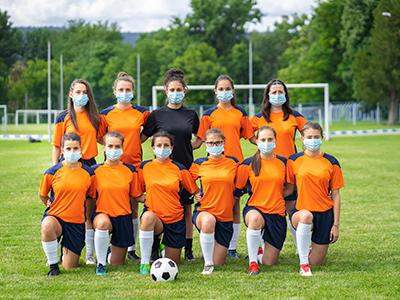soccer team wearing masks