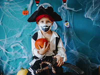 boy in mask dresses as pirate