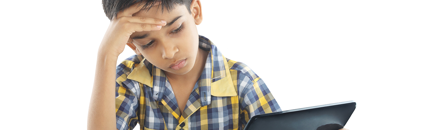 boy with a headache looking at a screen
