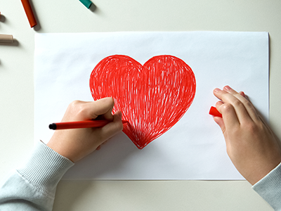 child drawing a heart
