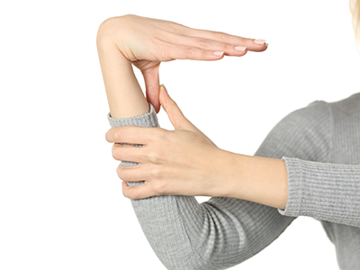 Hypermobile person bending thumb