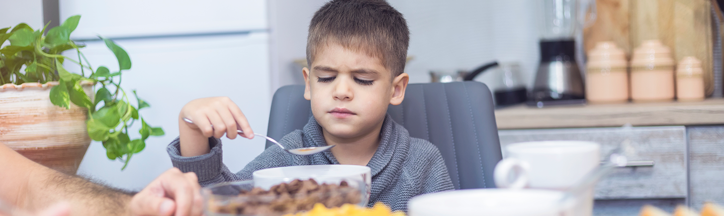 boy at table refusing to eat