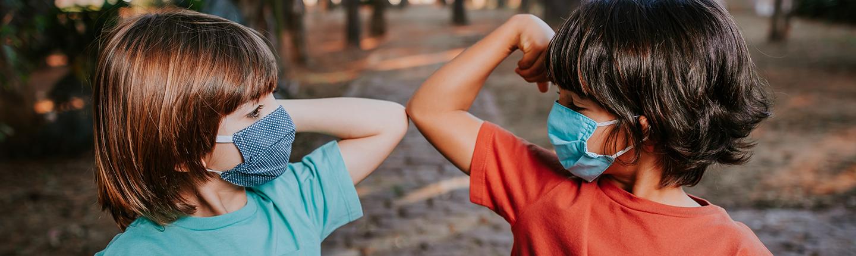 two kids doing elbow handshake