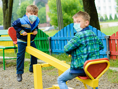 boys with masks in playground
