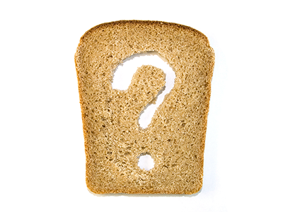 Slice of bread with a question mark cut out from it