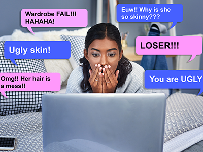 girl reading negative comments on a laptop