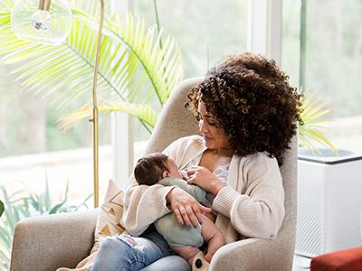 mom breastfeeding newborn